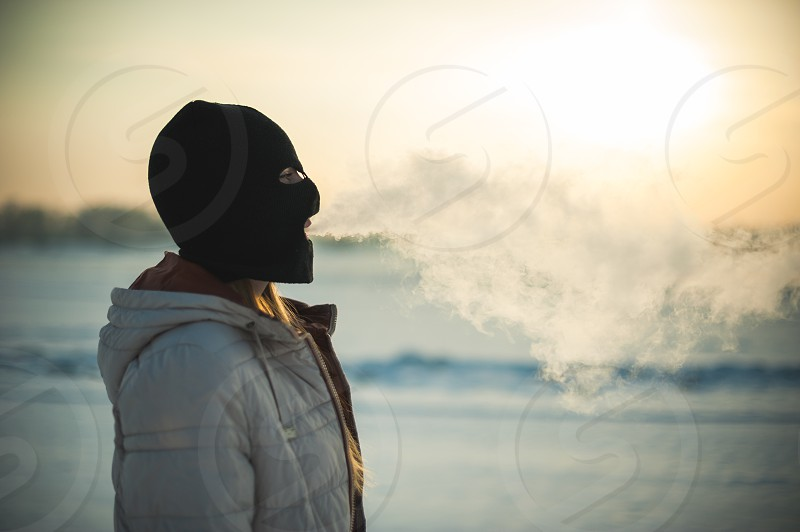 smoking an electronic cigarette outdoors in winter photo