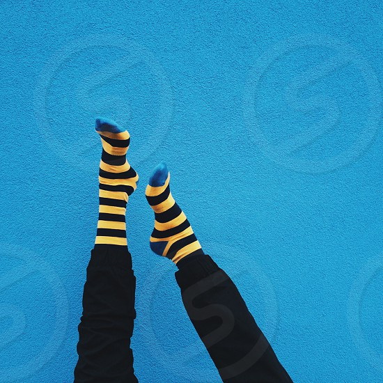 person wearing yellow black and blue high rise socks photo