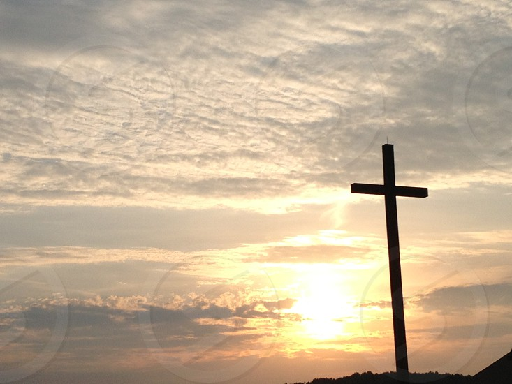 Cross at sunset photo