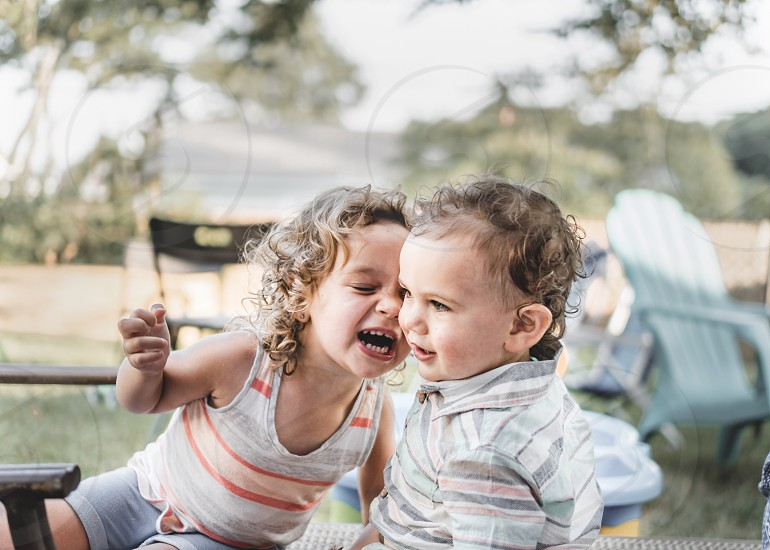 Toddlers sharing a laugh photo