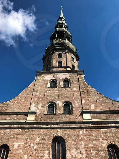 Outdoor day vertical portrait colour Riga Latvia Europe European architecture building St. Peter's Church Holy religious religion christian Christianity travel tourist tourism wanderlust Summer capital city steeple photo