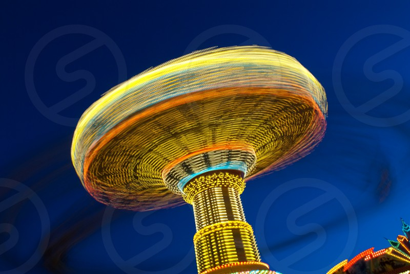 yellow orange and blue round tower building  photo