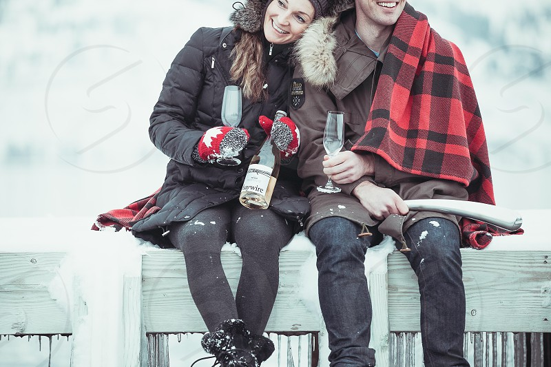 Couple- New Years celebration winter scene with champagne photo