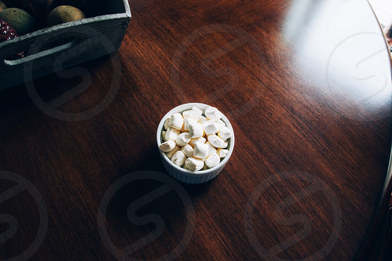 white marshmallows on white round bowl photo