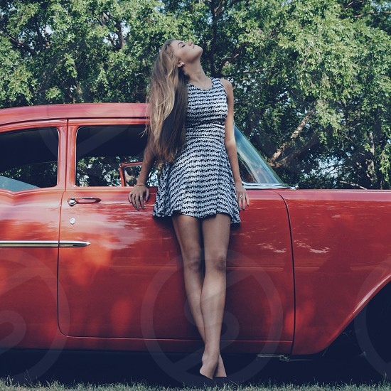 girl and red vintage car photo