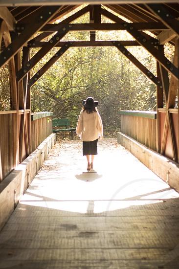 woman bridge walking journey covered bridge photo