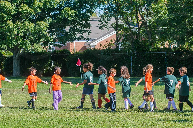 children player greeting each other before a match photo