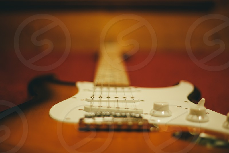 brown electric guitar photo