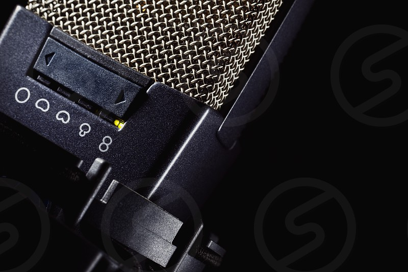 Head details of a microphone switchers for various frequencies and volume.  photo