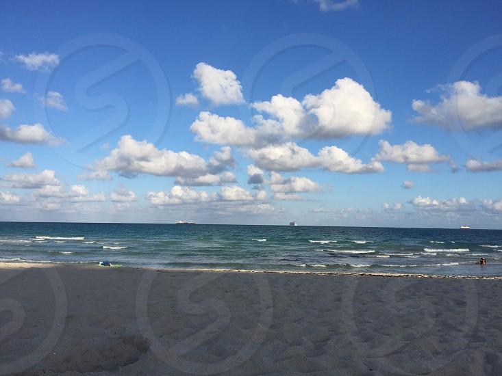 Beach sky ocean blue sand sandy photo