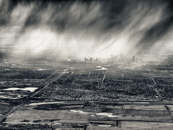 black and white photograph of the rain falling on the city photo