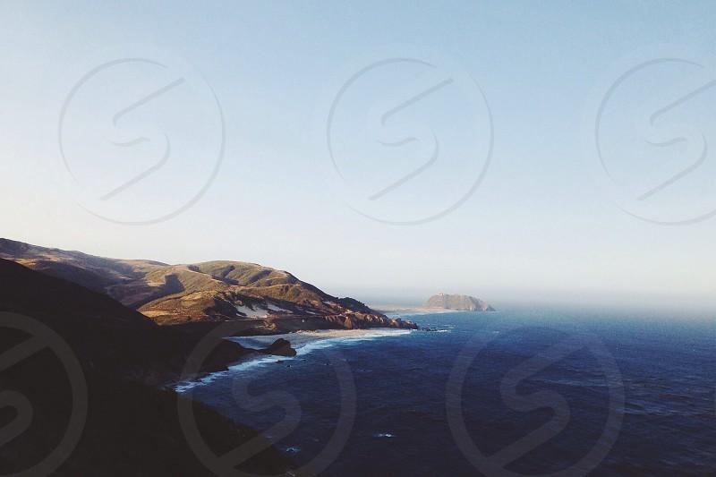 sea and mountain view photograph photo
