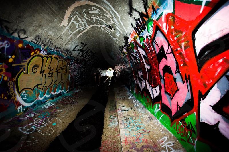 tunnel with graffiti artwork photo