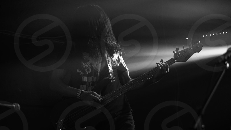 Guitar guitarist rocking out black and white long hair male stage stage light photo