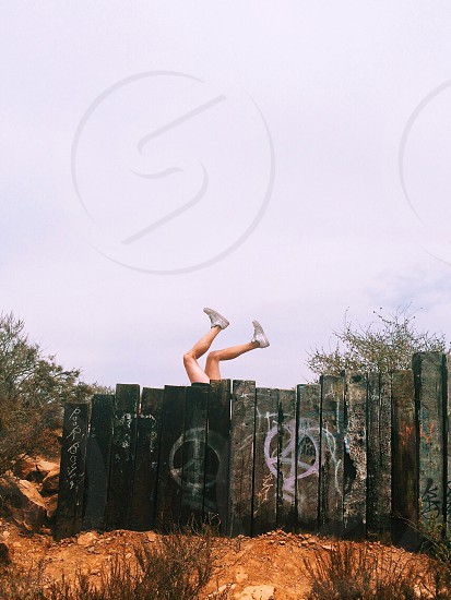 person in white sneakers in an upside down positiion photo