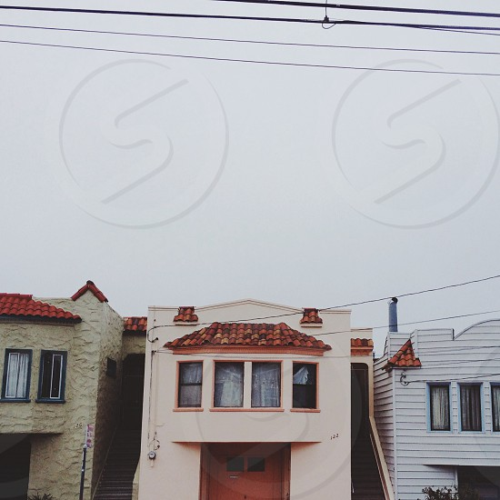 white painted duplex house photo