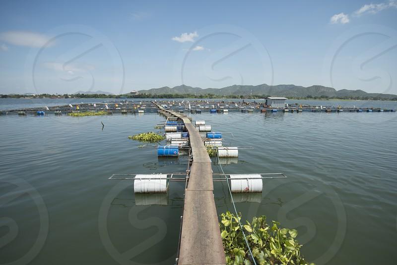 a fishfarm in the River Kwai near the City of Kanchanaburi in Central Thailand in Southeastasia.   photo