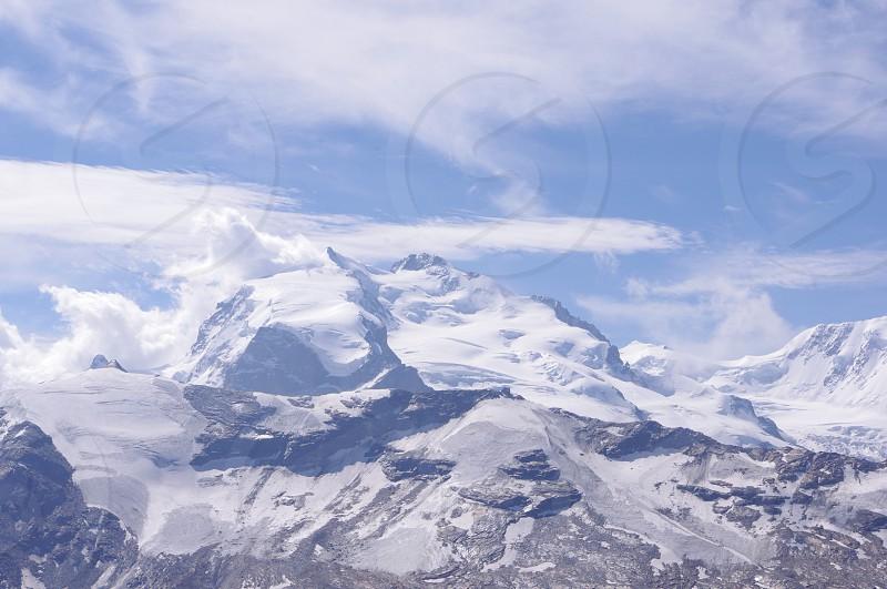 snow covered mountain peak photo