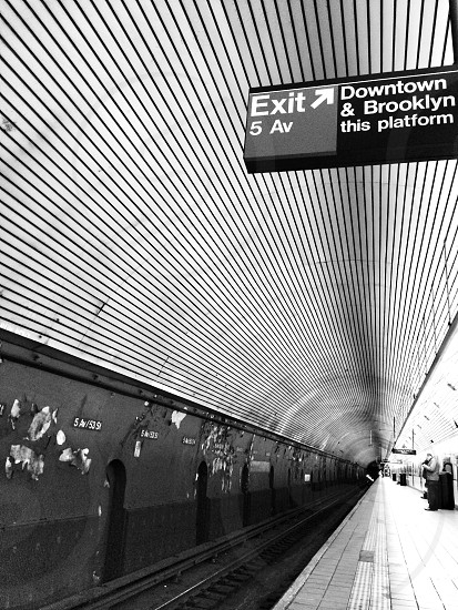 black and white photography of a train station photo