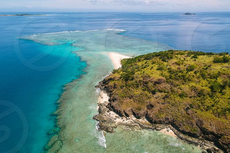 fiji drone aerial blue green aqua ocean island tropical beach reef coral wave travel paradise adventure private island remote  photo