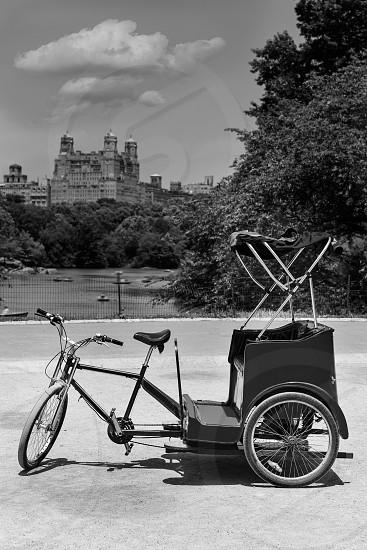 Central Park Manhattan The Lake rickshaw bike New York US photo