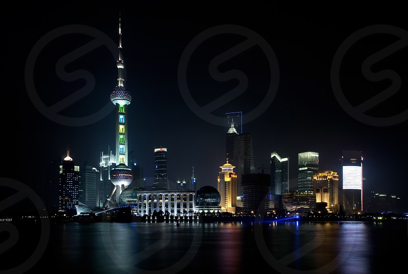 shanghai pudong side skyline by night illuminated for chinese new year photo
