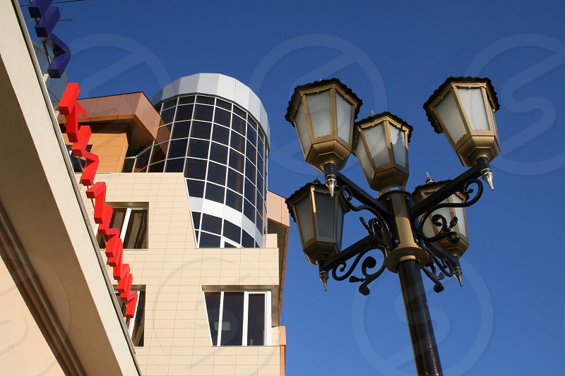 5-lamp post near building during daytime photo