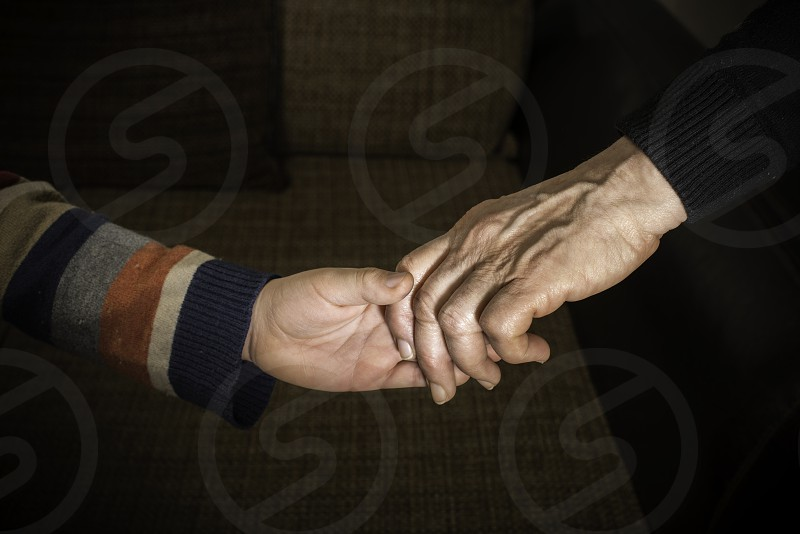 Two hands caught. Adult and child hand photo