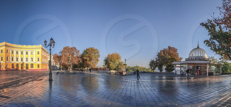 Odessa Ukraine - 10.12.2018. Panoramic view of Odessa seaside boulevard and sculpture of the founder of the city щn a sunny autumn morning photo