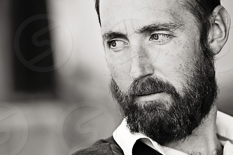 bear bearded man moustache black and white face facial expression facial hair hair close up expression expressed concerned think thinking pondering pensive thought male guy masculine eyes freckles blunt photo