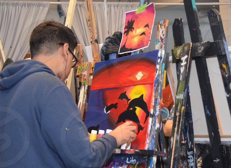 Millennial Artist painting studio photo