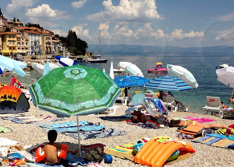 Beach umbrella sea sun photo