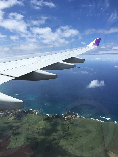 Airplane wing flight Hawaii Hawaiian airlines sky island land  photo