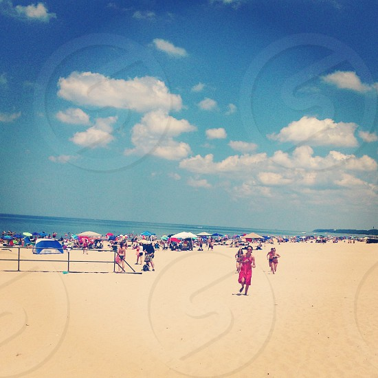 """Crisp"" A colorful beach is busy with visitors on the hot Summer day. photo"