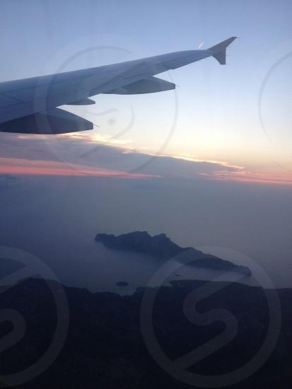 Flying sun set photo