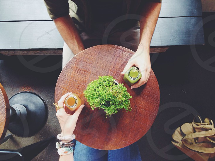 green potted plant on the center of round table photo