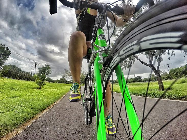 woman riding on green road bike photo