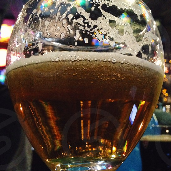 beer in a wine glass close up photo