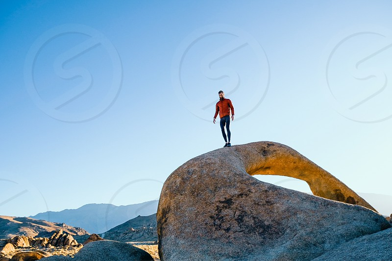 hiker in the desert arches photo