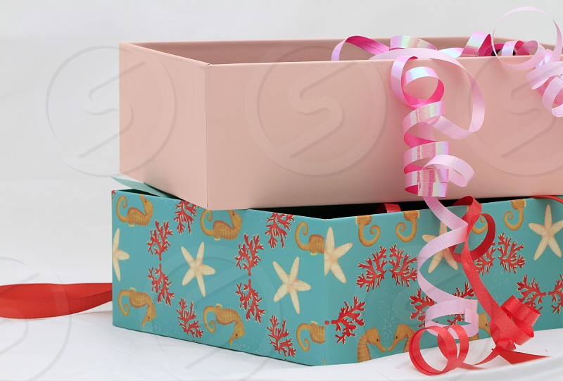 colorful boxes gift boxes in color color ribbons of gift boxes ribbon red ribbon black ribbon pink ribbon yellow box pink box photo