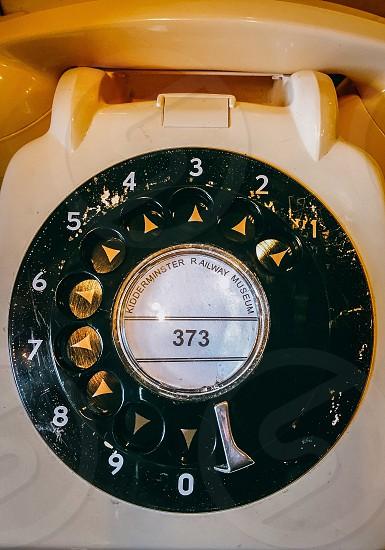white and green rotary telephone photo