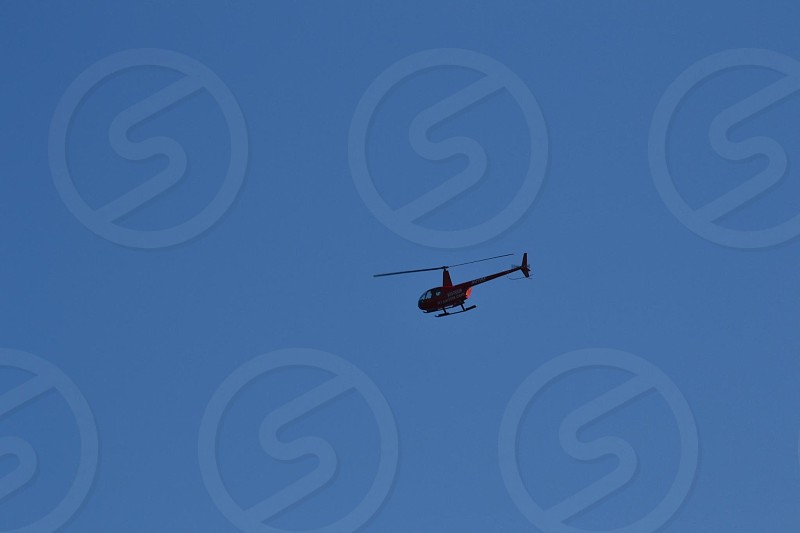 helicopter flying in the sky photo