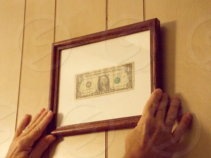1 us dollar bill with framed photo
