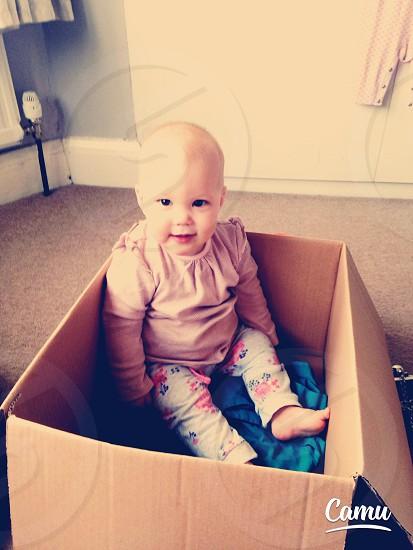 Baby in a box smiler daughter toddler girl photo