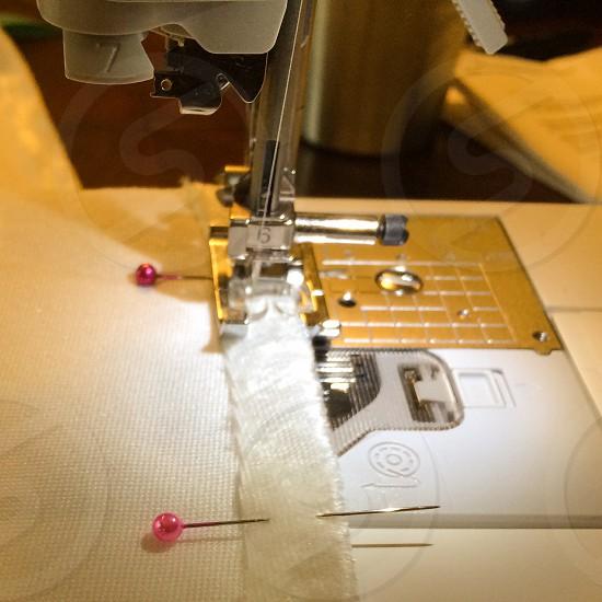 Sewing machine white fabric pink pins photo