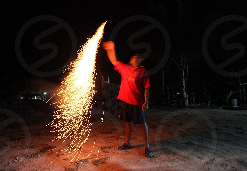people play with firework near the city of Amnat Charoen in the Region of Isan in Northeast Thailand in Thailand.
