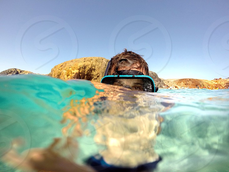 person with scuba mask under water photo