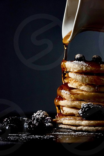 Pancakes blueberry blackberries syrup cup stack maple syrup sugar photo