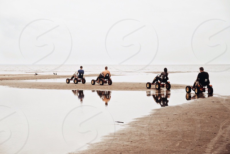 Outdoors outdoor lifestyle weekend friends river sea beach seashore sand people riding sport free time holiday freedom photo