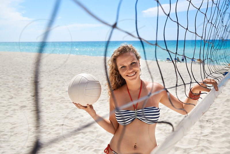 woman; varadero; volley; girl; cuba; ball; beach; 20s; active; activity; adult; beautiful; bikini; blond; carefree; caribbean; carribe; caucasian; cheerful; confident; enjoy; female; fun; happy; holidays; joy; leisure; lifestyle; looking; looking at camera; net; ocean; one; outdoor; people; person; portrait; positive; pretty; sand; sea; smile; smiling; sport; summer; swimsuit; vacations; waist up; water; young photo